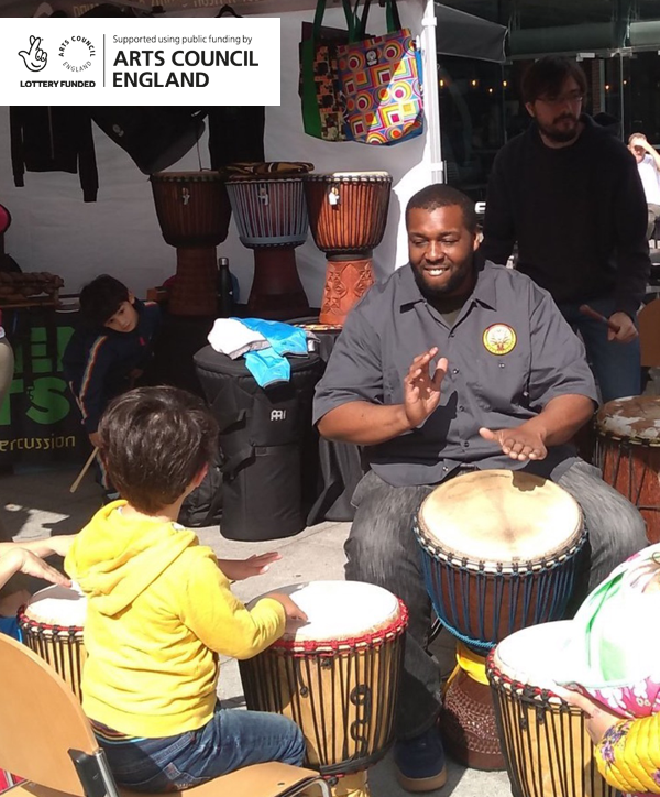 Man playing West African drum
