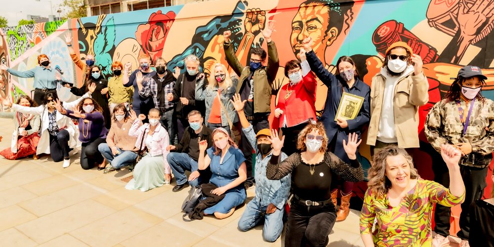 Participants celebrate completion of the mural